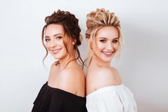 Studio portrait of two young beautiful women stock image