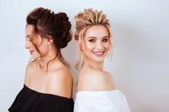 Studio portrait of two young beautiful women stock photography