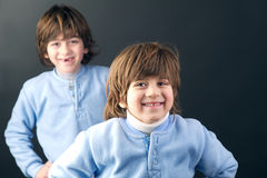 Studio portrait of two young brothers posing stock photography
