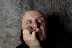 Unsure Man Gazing. Studio portrait of unsure man with a side gaze, selective focus closeup royalty free stock images