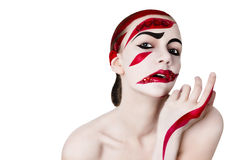 Studio portrait of a woman. Art make-up in red Royalty Free Stock Photos