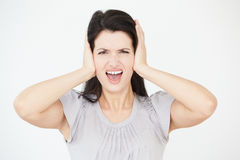 Studio Portrait Of Woman Covering Ears With Hands Royalty Free Stock Photography