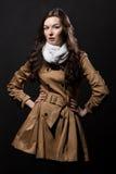 Studio portrait of woman on dark background Stock Photo