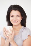 Studio Portrait Of Woman With Hot Drink Royalty Free Stock Photo