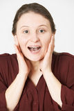 Studio Portrait Of Woman With Shocked Expression Stock Images