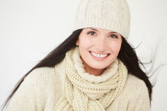 Studio Portrait Of Woman Wearing Warm Winter Clothes Royalty Free Stock Photography