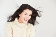 Studio Portrait Of Woman Wearing Warm Winter Clothes Stock Photo