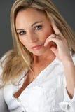 Studio Portrait Of Woman Wearing White Shirt Stock Image