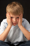 Studio Portrait Of Worried Boy Royalty Free Stock Photo