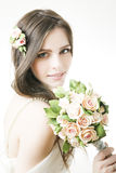Studio portrait of a young beautiful bride with a bouquet Royalty Free Stock Images