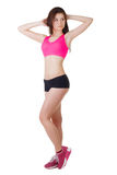 Studio portrait of a young beautiful sporty woman wearing sports shorts and top Royalty Free Stock Photos