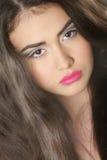 Studio portrait of young beautiful woman Stock Photos