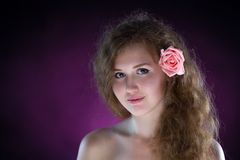 Studio portrait of young beautiful woman with roses in the smoke Stock Photo