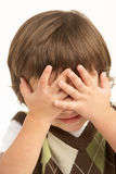 Studio Portrait Of Young Boy Covering Eyes Stock Photos