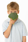 Studio Portrait Of Young Boy Holding Broccoli Royalty Free Stock Images