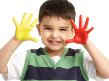 Studio Portrait Of Young Boy With Painted Hands Stock Photo