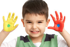 Studio Portrait Of Young Boy With Painted Hands Royalty Free Stock Photo