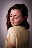Studio portrait of a young brunette woman Royalty Free Stock Photography