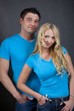 Studio Portrait Of Young Couple Stock Photos