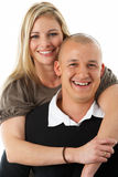 Studio Portrait Of Young Couple Hugging Royalty Free Stock Image