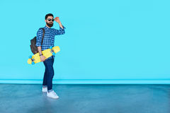 Studio portrait of young fashionable hipster man posing Royalty Free Stock Photography
