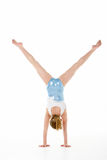 Studio Portrait Of Young Female Gymnast. Doing handstand royalty free stock photo