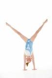 Studio Portrait Of Young Female Gymnast. Doing hanstand stock photo