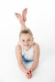 Studio Portrait Of Young Female Gymnast. Laying on stomach stock photography