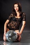 Studio portrait of young girl with disco ball Royalty Free Stock Image