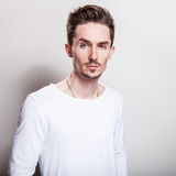 Studio portrait of young handsome man in casual simple white t-shirt Stock Photography