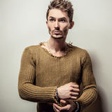 Studio portrait of young handsome man in knitted sweater. Close-up photo. Stock Images