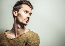 Studio portrait of young handsome man in knitted sweater. Close-up photo. Stock Photo