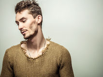 Studio portrait of young handsome man in knitted sweater. Close-up photo. Stock Image