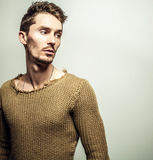 Studio portrait of young handsome man in knitted sweater. Close-up photo. Royalty Free Stock Images