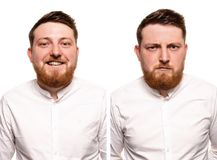 Studio portrait of young handsome smiling and serious ginger man with beard. Studio portrait of young handsome smiling ginger man with red beard royalty free stock images