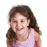 Studio portrait of young happy smiling preschooller girl over wh. Ite background Royalty Free Stock Photos