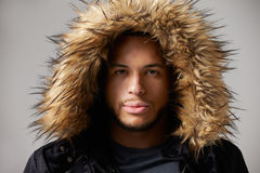 Studio Portrait Of Young Man Wearing Winter Coat Royalty Free Stock Image