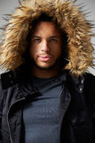Studio Portrait Of Young Man Wearing Winter Coat Royalty Free Stock Images