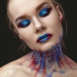 Portrait of beautiful girl with blue tones makeup Royalty Free Stock Photo