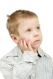 Studio portrait of young pensive beautiful boy Royalty Free Stock Images