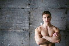 Studio portrait young men bodybuilder athlete, with a bare torso