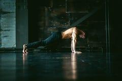 Studio portrait young men bodybuilder athlete, with a bare torso royalty free stock photo