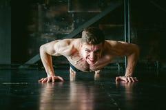 Studio portrait young sexy men bodybuilder athlete, with a bare torso Stock Photos