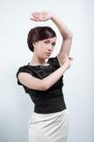Studio portrait of young woman Stock Image