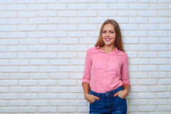 Studio portrait of young woman with beautiful healthy face and l royalty free stock photo