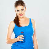 Studio portrait of young woman with bottle of water Royalty Free Stock Images