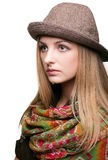 Studio portrait of young woman in hat Royalty Free Stock Image
