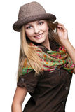 Studio portrait of young woman in hat Stock Image