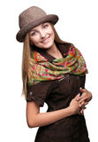 Studio portrait of young woman in hat Royalty Free Stock Photography