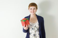 Studio portrait of young woman holding gift box Stock Photo